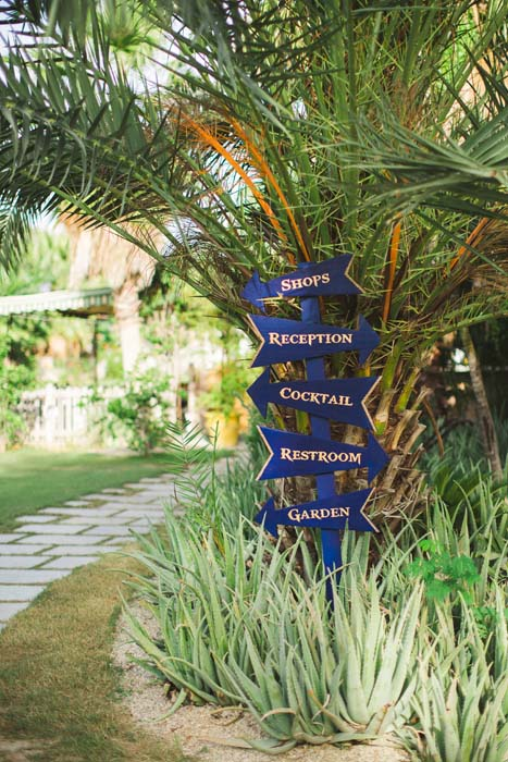 Photo of the directions sign in the matching blue for a cabo wedding. - Sarah and Justice wedding pic3