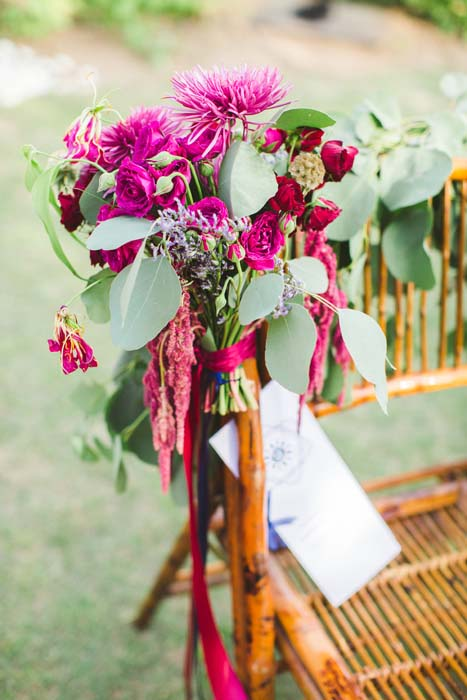 Photo of accent flowers on a rattan chair from Sarah and Justice's wedding. - Sarah and Justice wedding pic5