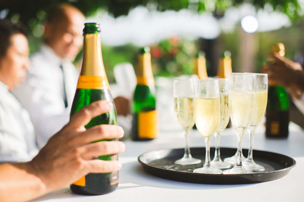 Photo of full champagne glasses at a Cabo Wedding. - Sarah and Justice wedding pic14