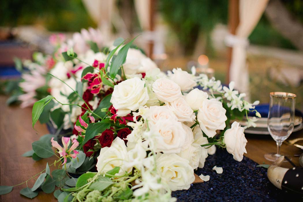 Photo of white and red roses on the dining table in a Cabo wedding. - Sarah and Justice wedding pic10
